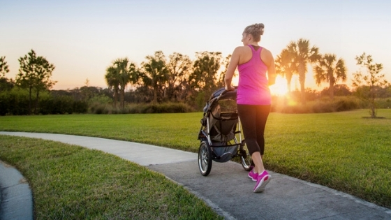 Mom running with baby in jogging stroller